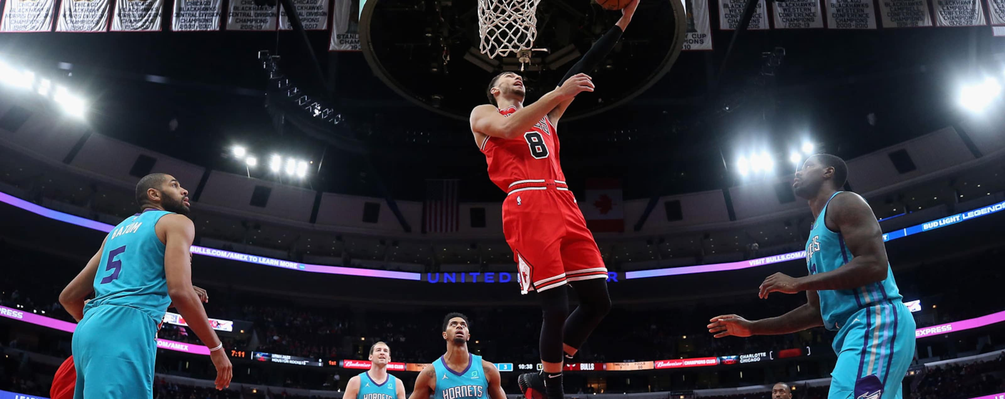 Zach LaVine #8 of the Chicago Bulls drives the lane to put up a shot against the Charlotte Hornets at the United Center on October 24, 2018 in Chicago, Illinois.