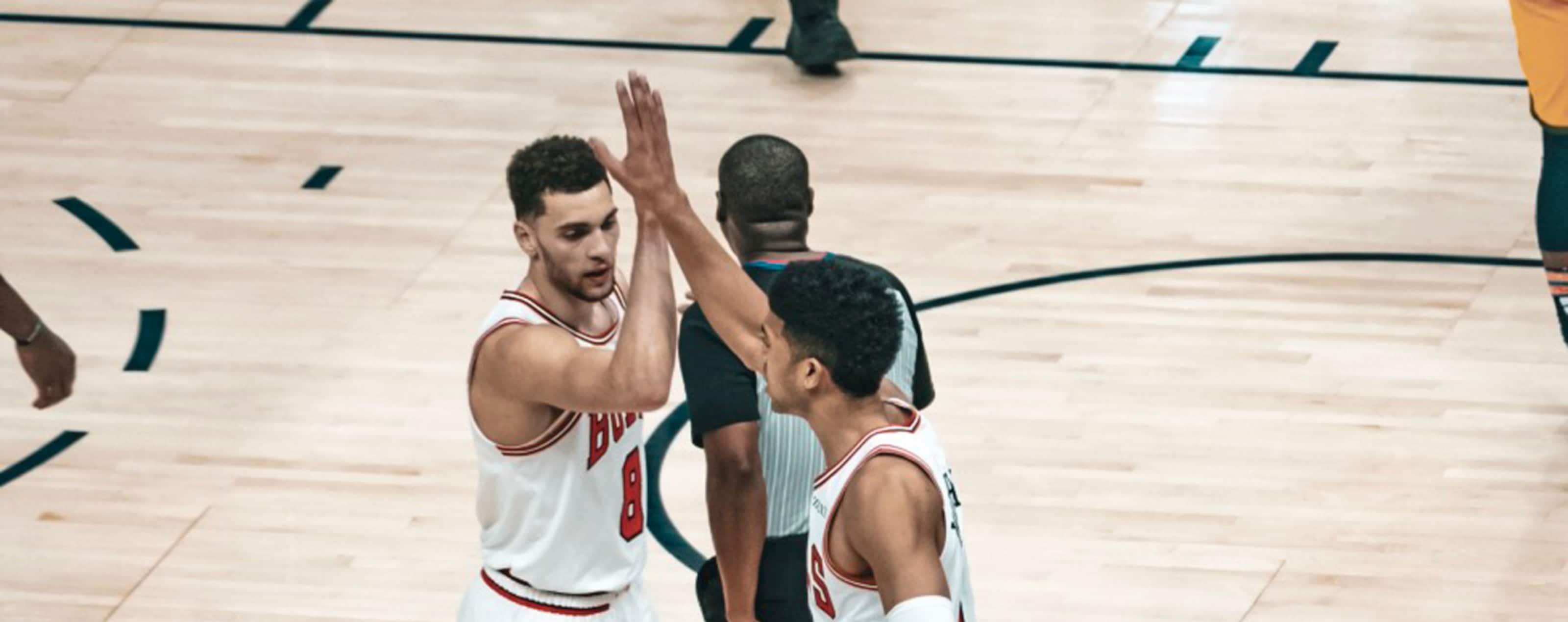 Zach LaVine and Chandler Hutchison react with a high-five against the Utah Jazz.