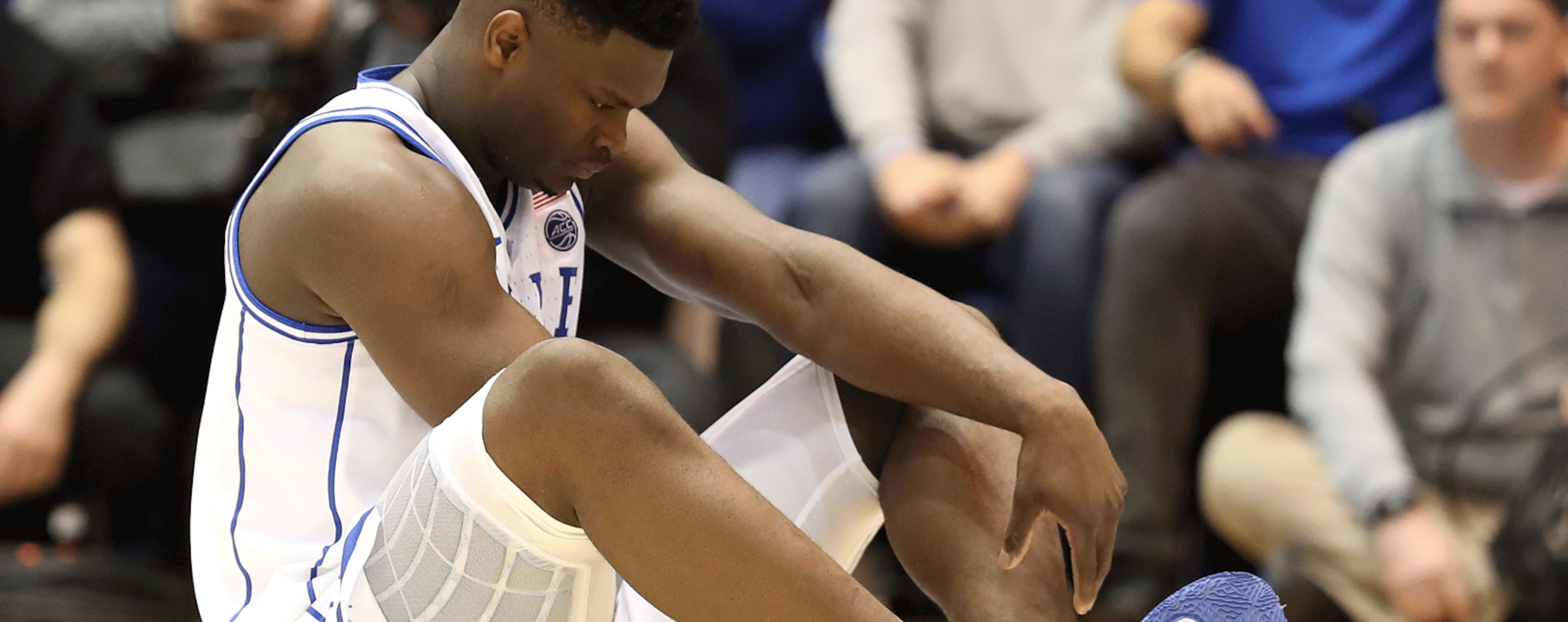 Zion Williamson #1 of the Duke Blue Devils reacts after falling as his shoe breaks against Luke Maye #32 of the North Carolina Tar Heels during their game at Cameron Indoor Stadium on February 20, 2019 in Durham, North Carolina.