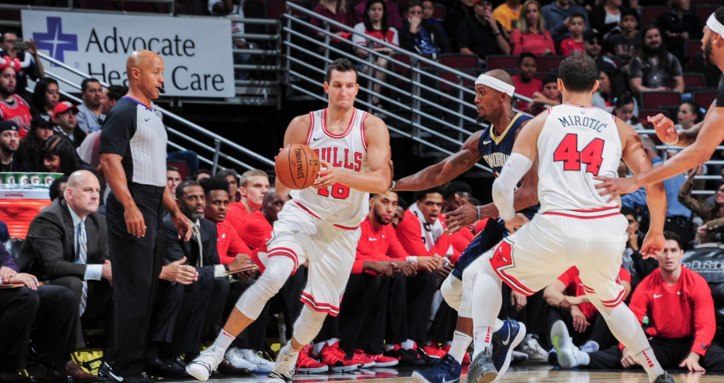 Paul Zipser #16 of the Chicago Bulls handles the ball during the preseason game against the New Orleans Pelicans on October 8, 2017 at United Center in Chicago, Illinois.