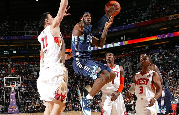 da07096fbe6 LeBron James  23 of the Eastern Conference drives for a shot attempt  against Yao Ming