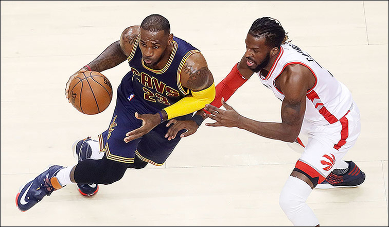 Irving, James help Cavs hold off Raptors 94-91