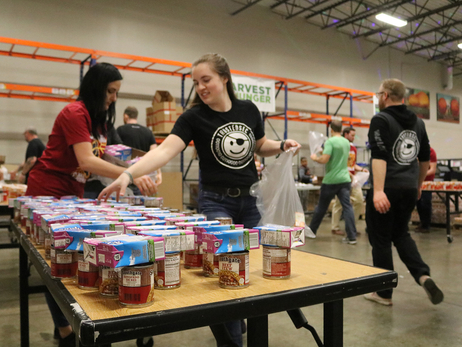 Cedi, Tristan Race to Pack Food at Greater Cleveland Food Bank