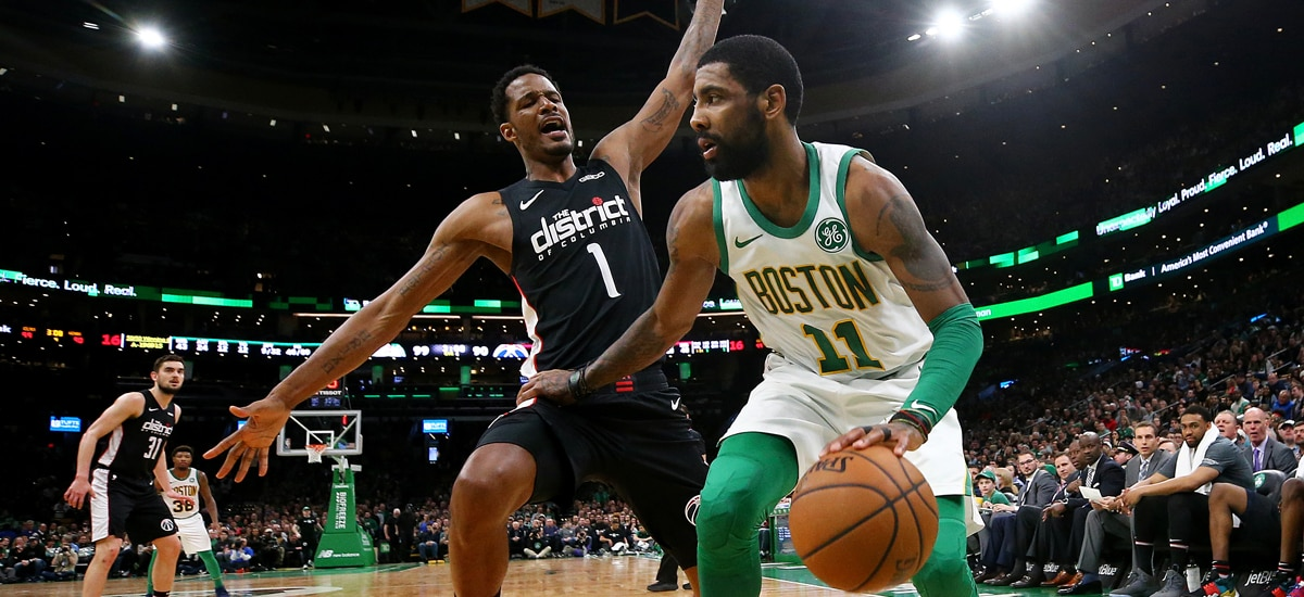 4a15f017341 Kyrie Irving drives against Trevor Ariza