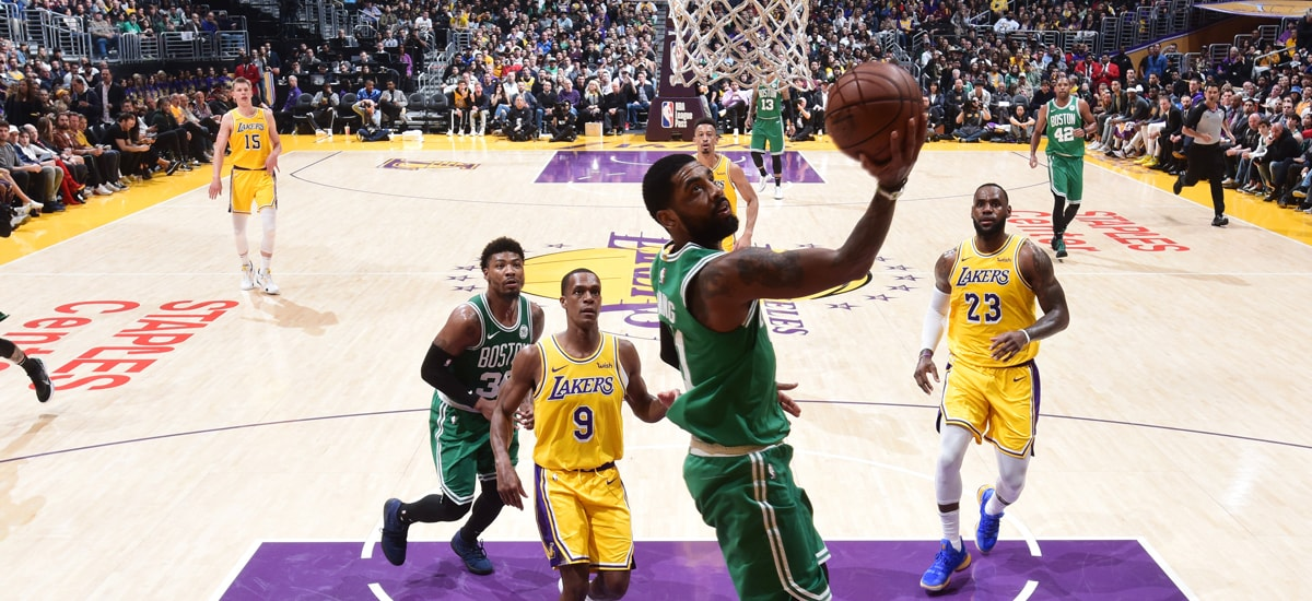 Kyrie Irving drops in a reverse layup against the Lakers