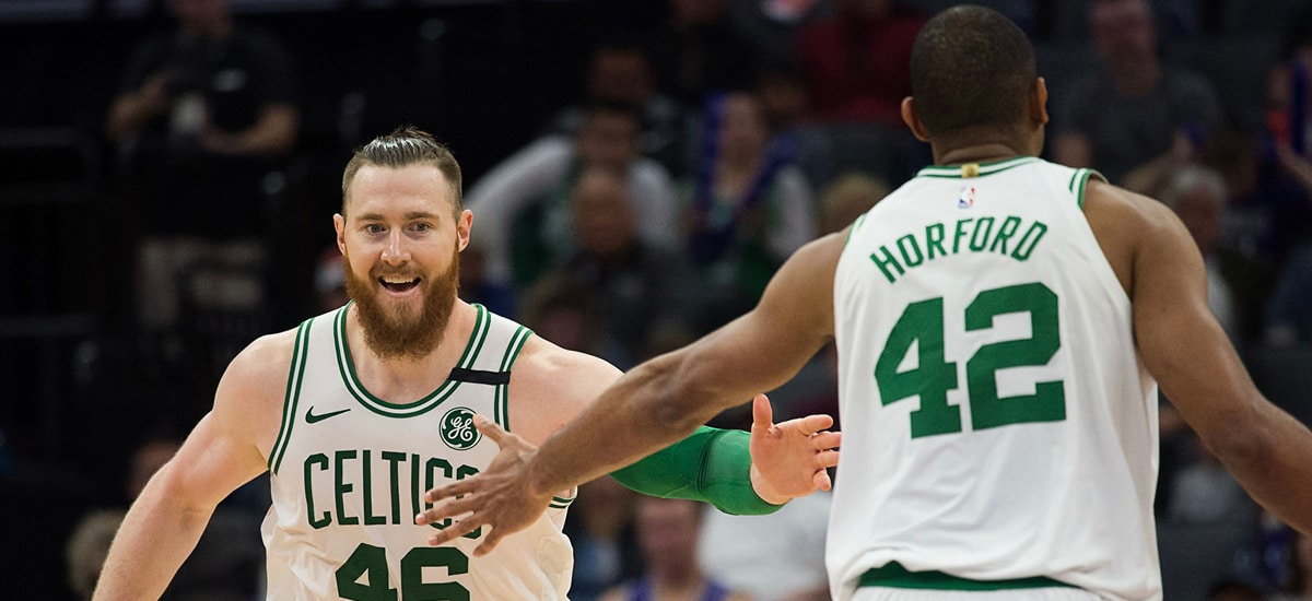Aron Baynes and Al Horford slap hands on the court
