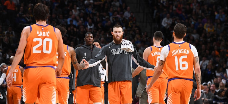 Aron Baynes slaps his teammates up as they walk off the court