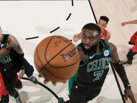 Jaylen Brown drops in a layup against Portland