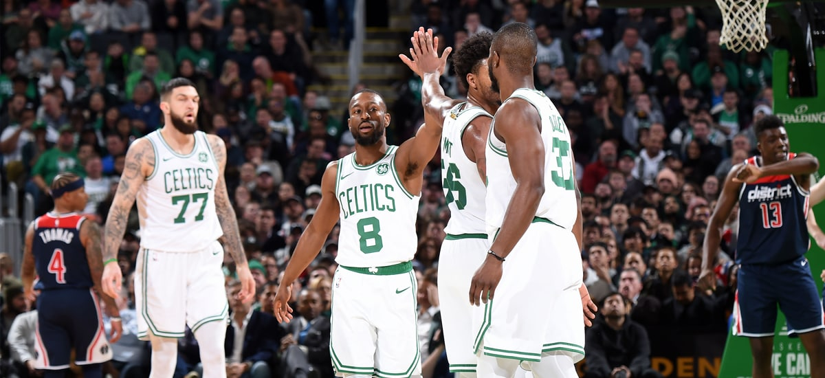 Kemba Walker and the Celtics celebrate a win against Washington