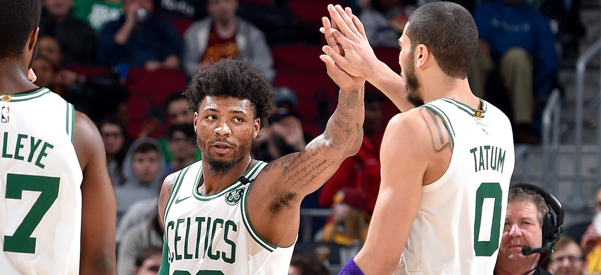 Marcus Smart and Jayson Tatum slap high-fives during a win in Cleveland