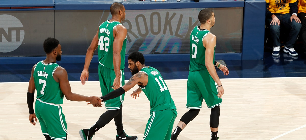 Jaylen Brown, Al Horford, Kyrie Irving and Jayson Tatum head to a timeout in Indiana