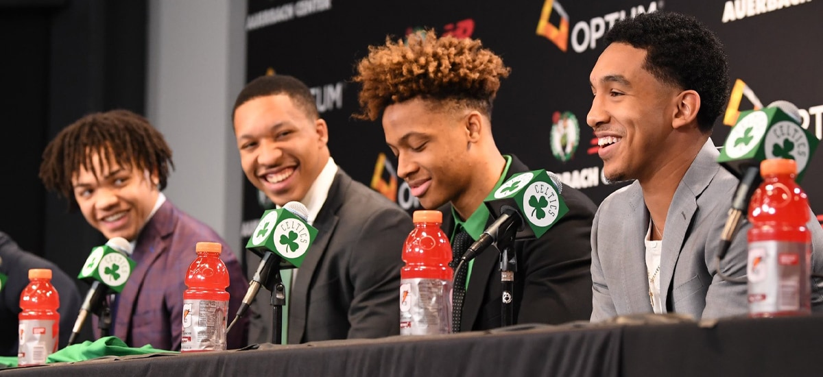 Carsen Edwards, Grant Williams, Romeo Langford and Tremont Williams smile at their introductory press conference