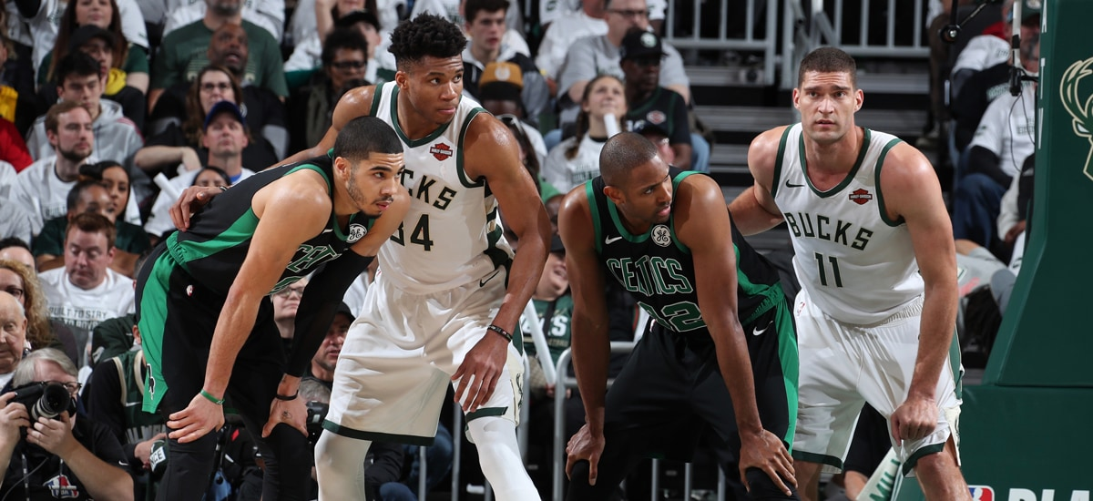 Tatum, Antetokounmpo, Horford and Lopez wait for a play to begin