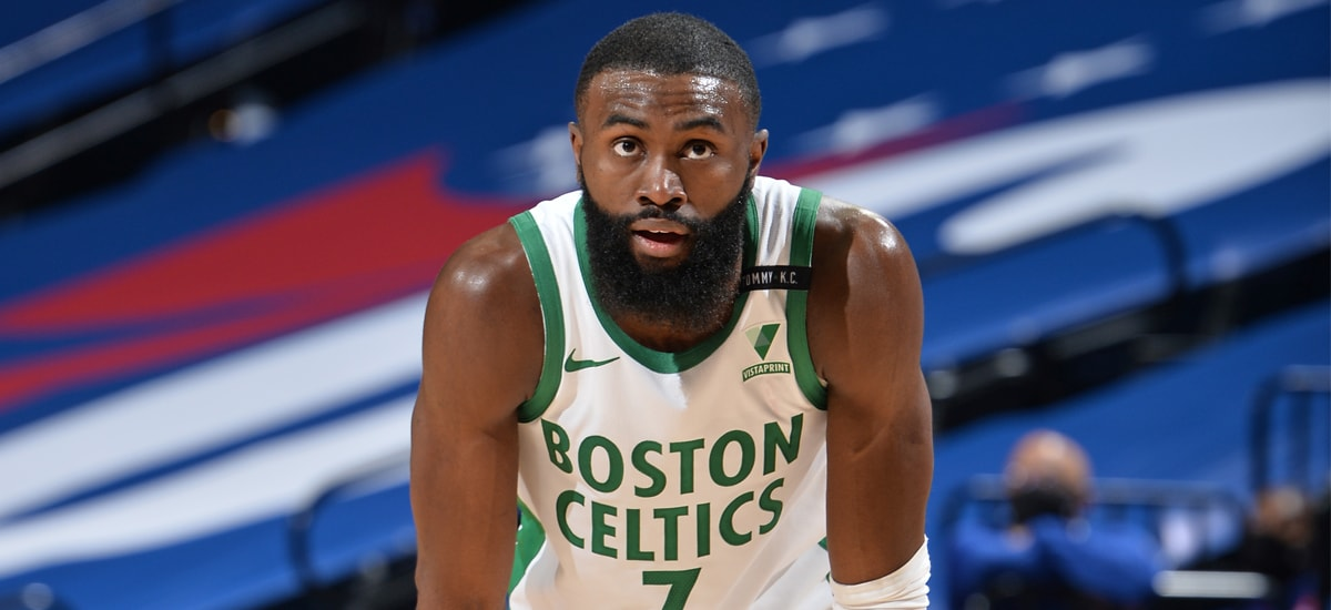 Jaylen Brown stands with his hands on his knees during a loss to Philadelphia