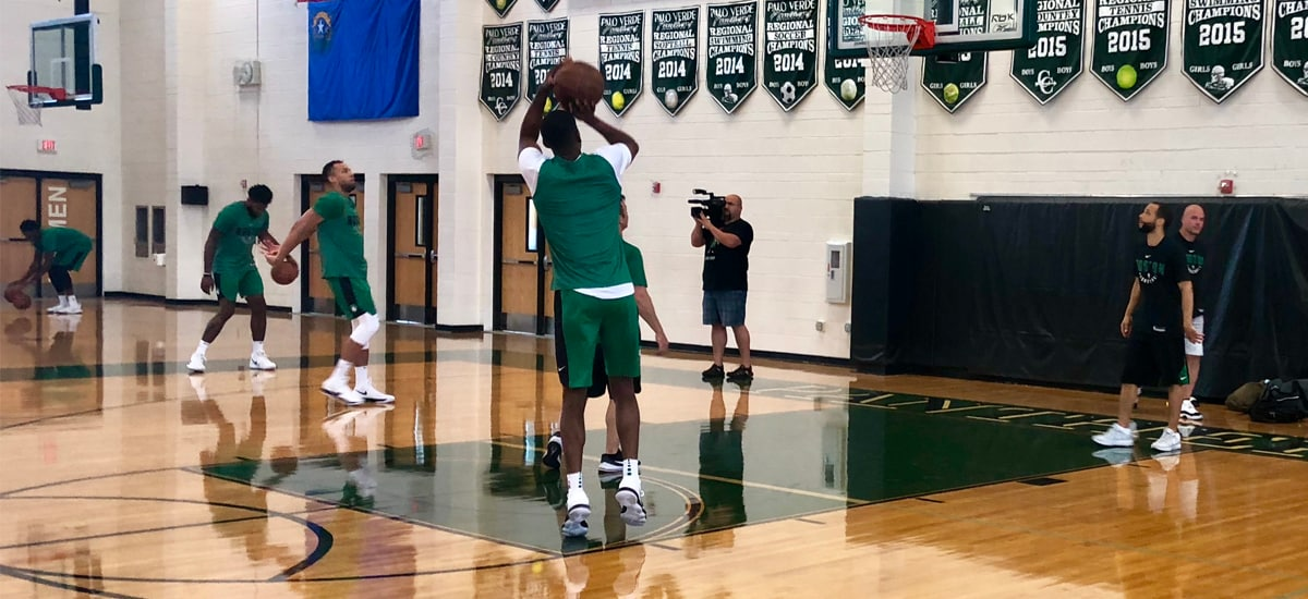 The Celtics warm up before practice in Las Vegas