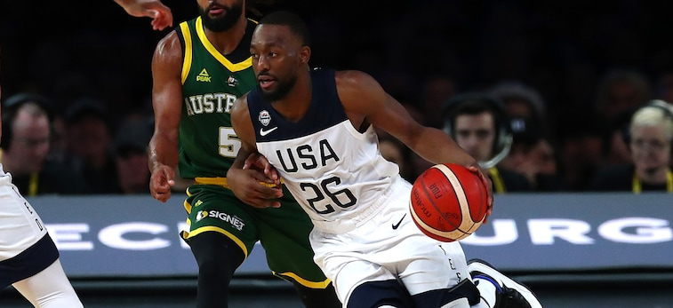 Kemba Walker drives to the basket against Australia