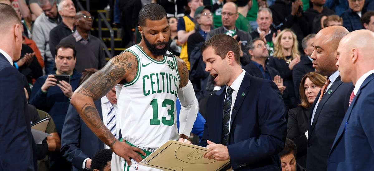 Brad Stevens draws up a play for Marcus Morris on a clipboard