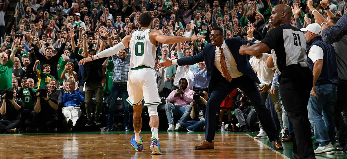 Jayson Tatum high-fives Paul Pierce along the sideline during a memorable comeback at TD Garden