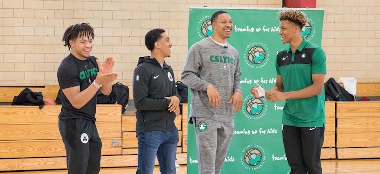 Carsen Edwards, Tremont Waters, Grant Williams and Romeo Langford smile at their first community event as Celtics