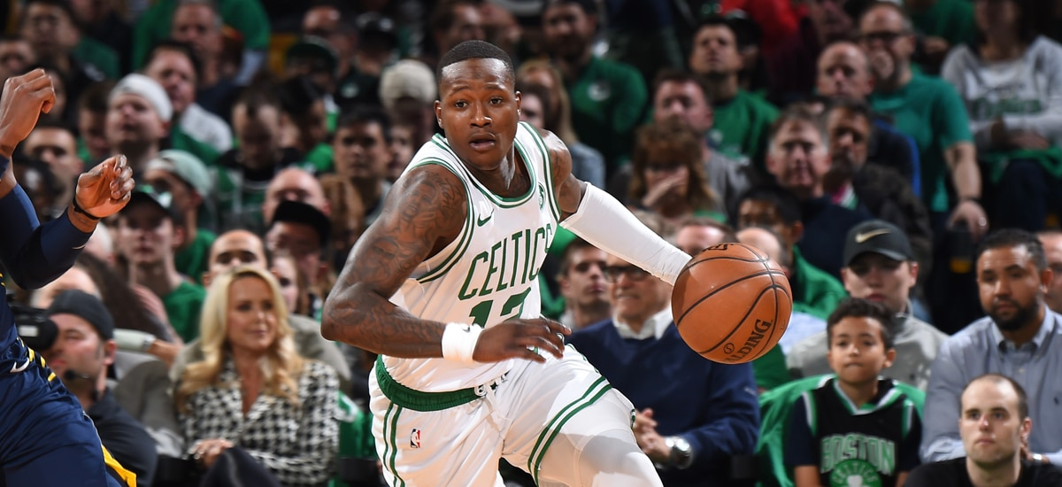 Terry Rozier dribbles the ball against Indiana