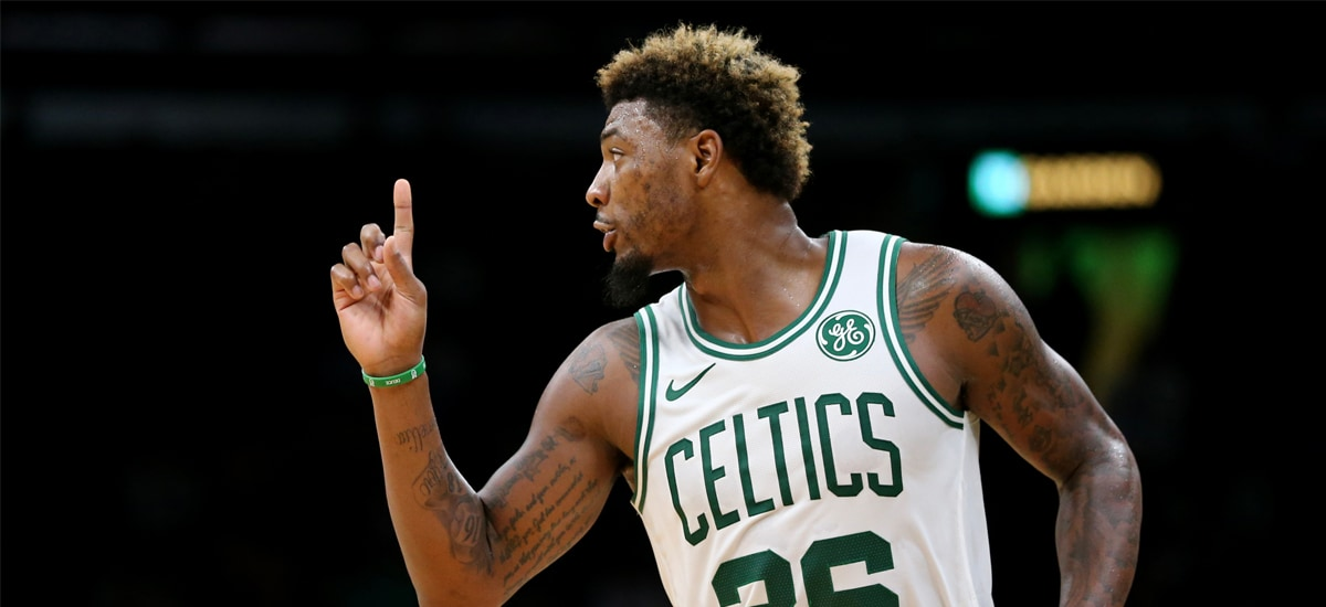 Marcus Smart waves a finger