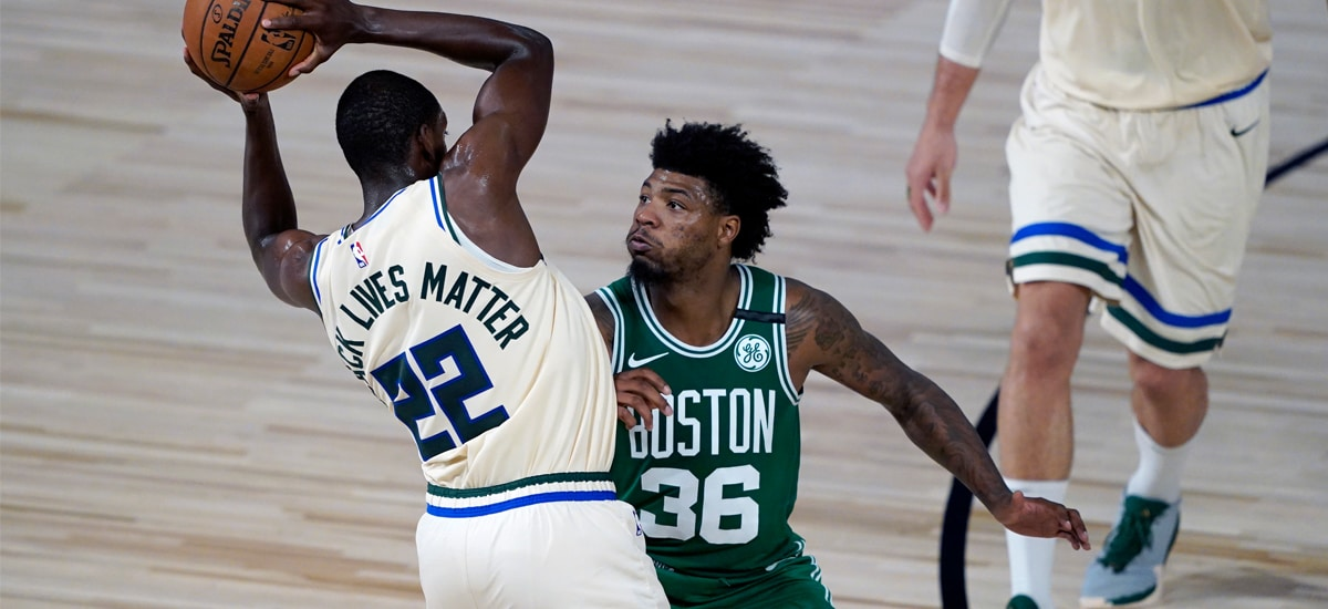 Marcus Smart's defense pushes Khris Middleton onto his heels