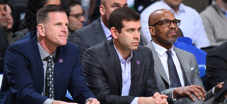 Brad Stevens sit on the bench during a Celtics game