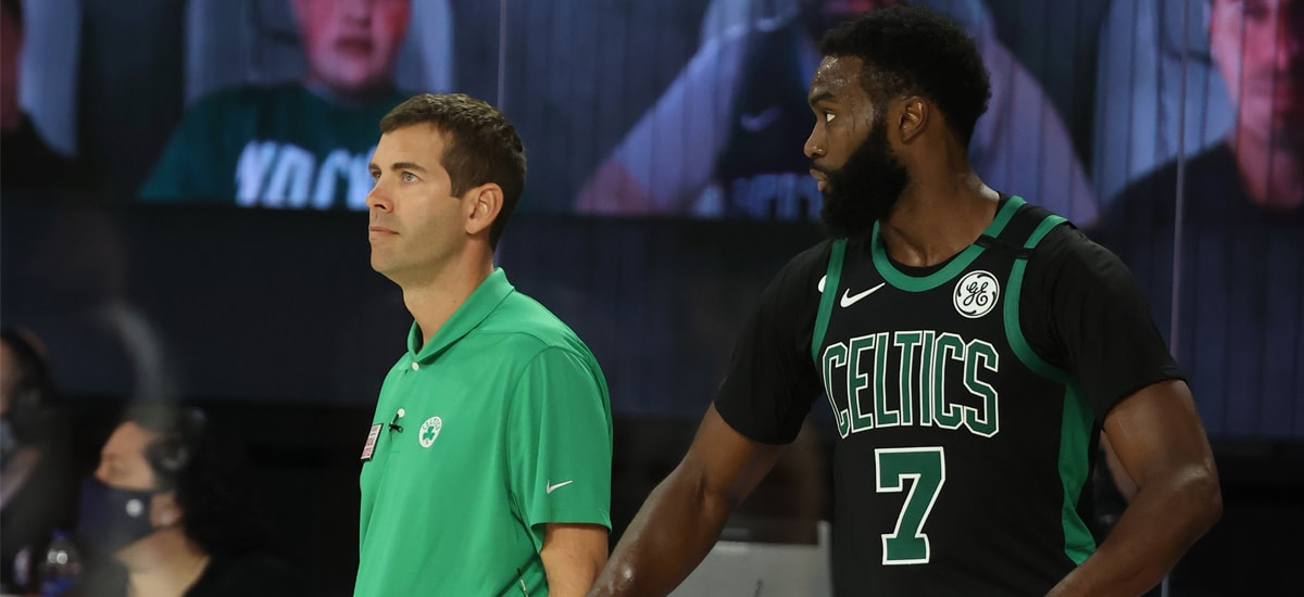 Brad Stevens and Jaylen Brown stand next to each other on the court inside the NBA's bubble
