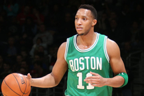 Evan Turner dribbles the basketball