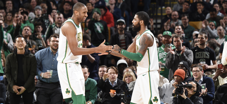 Al Horford and Kyrie Irving slap five