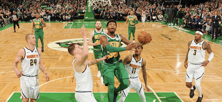Marcus Smart shoots a layup against Denver