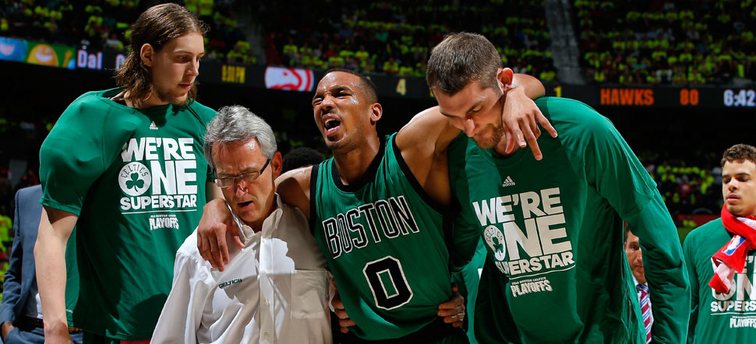 An injured Avery Bradley is carried off the court