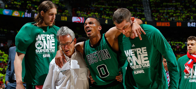 Avery Bradley is carried off the court by teammates in Atlanta