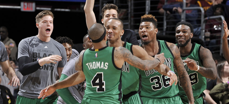 The Celtics celebrate a buzzer-beating win in Cleveland.