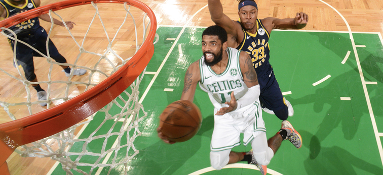 Kyrie Irving drives to the basket for a layup during Game 2
