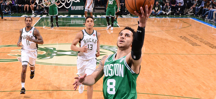Shane Larkin shoots a layup during Game 3 against Milwaukee