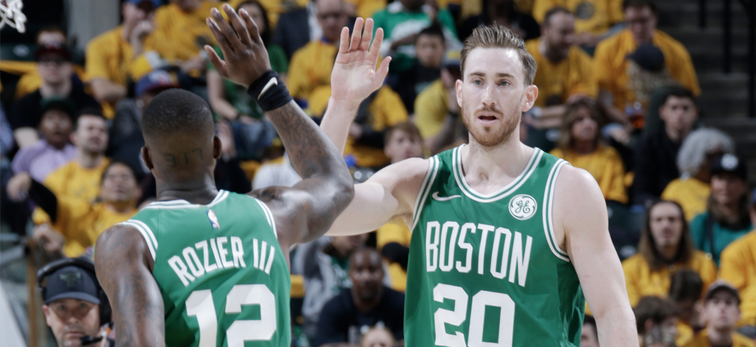 Terry Rozier and Gordon Hayward high five each other