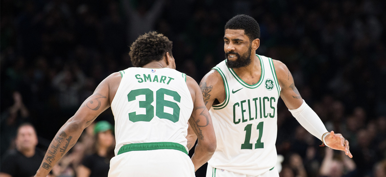 Marcus Smart and Kyrie Irving slap hands