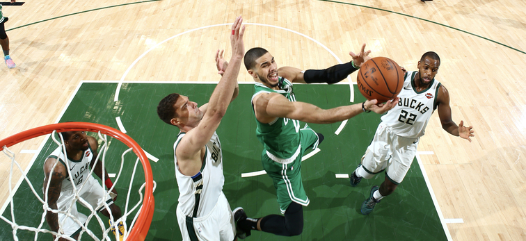 Jayson Tatum attempts a contested layup during Game 5 in Milwaukee