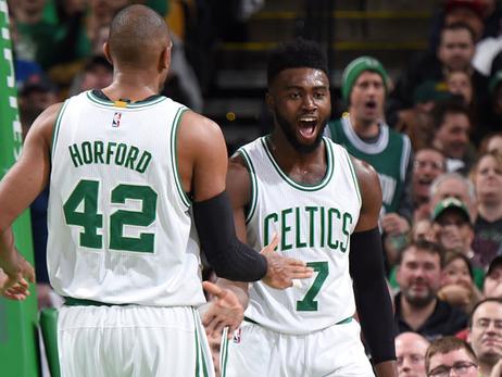 Al Horford and Jaylen Brown celebrate a basket