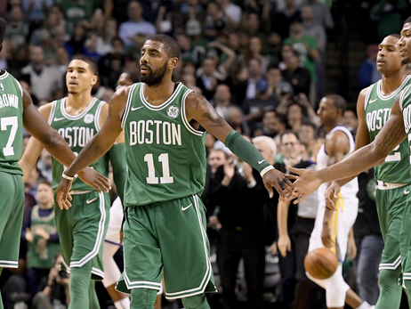 The Celtics slap five during their win over the Warriors