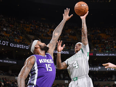 Isaiah Thomas shoots a floater over DeMarcus Cousins