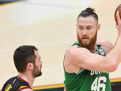 Aron Baynes holds the ball away from Kevin Love in Cleveland