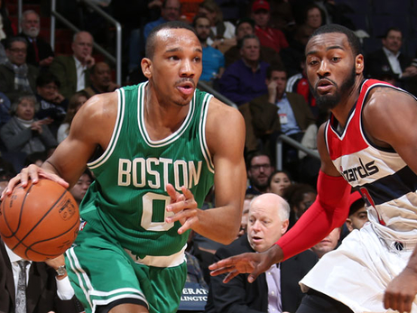 Avery Bradley drives past John Wall