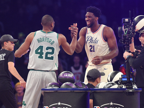 Al Horford and Joel Embiid slap hands after the Skills Challenge