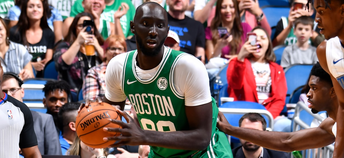 Tacko Fall posts up during a preseason game in Orlando