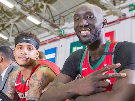 Bryce Brown and Tacko Fall give peace signs to the camera in Maine