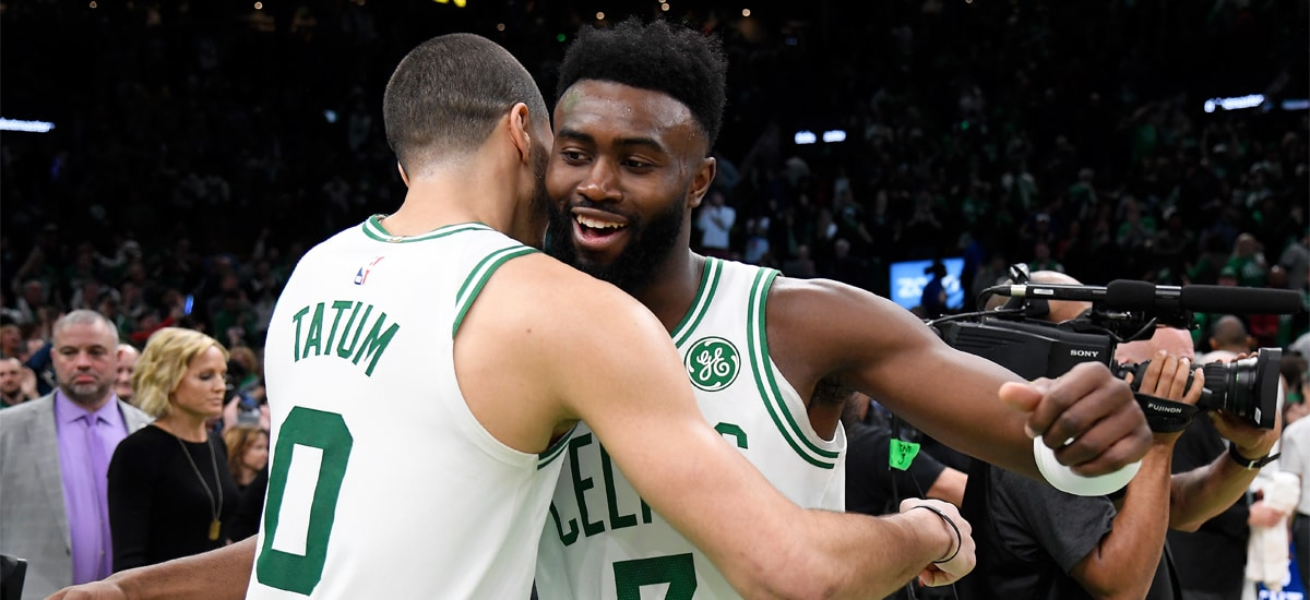 Jayson Tatum and Jaylen Brown hug it out with smiles after a game at TD Garden