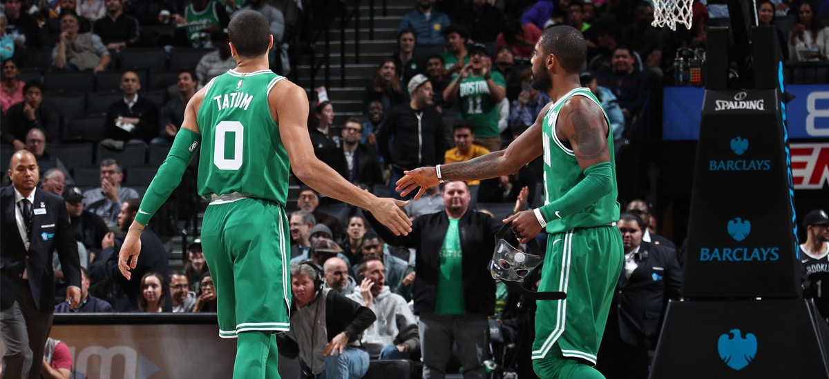 Jayson Tatum and Kyrie Irving slap hands