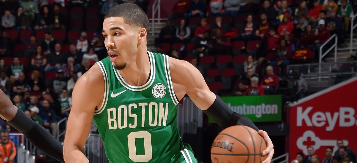 Jayson Tatum dives the ball against Cleveland